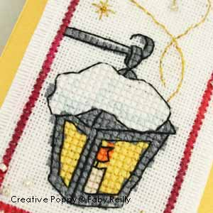cross stitch patterns with  a lantern, a red robin, a snowman and stars. (zoom1)