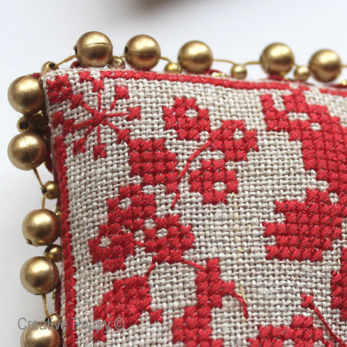 Finishing cross stitch ornaments with a beaded ribbon trimming