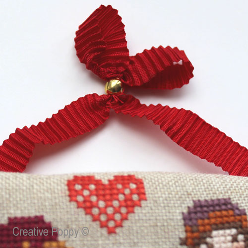A pleated ribbon for hanging your cross stitch ornaments