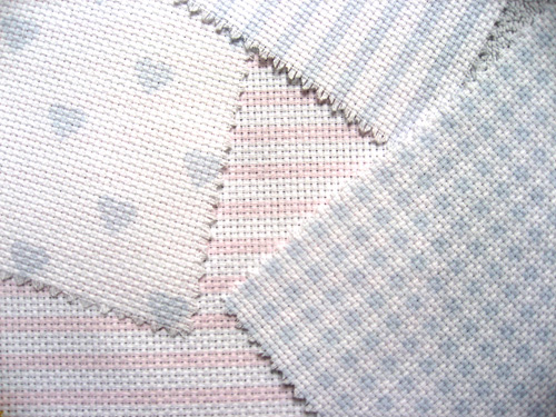 Gingham, stripes and hearts print motifs on DMC Needlework fabric