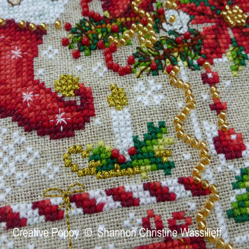 cross stitch pattern includes many fine details as well as golden thread highlights and beaded embellishments