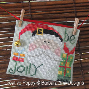 using tiny miniature clothes pegs for hanging cross stitch ornaments