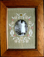Photo shows examples of designs stitched on 14ct DMC Linen Aida in color 842