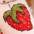 Teach a kid to cross stitch with