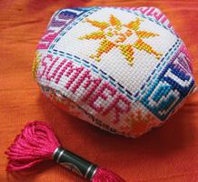 Sun & Summer biscornu stitched with the new DMC Satin floss range, a design by Marie-Anne Réthoret-Mélin
