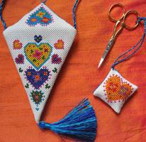 Scissor case and scissor fob,  stitched with the new DMC Satin floss range, a design by Marie-Anne Réthoret-Mélin