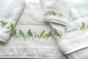 "The splendid ""parakeet"" design shown here is specifically designed for the DMC bathroom towel range:"
