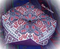 The original Biggie Biscornu wit carpet-style motifs