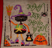 Rolande selected Barbara Ana's Halloween cat to stitch on the top part.