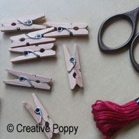 use miniature clothes pegs for hanging cross stitch  ornament