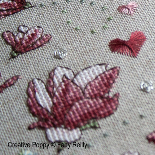 Magnolia flowers cross stitch patterns designed by <b>Faby Reilly Designs</b>